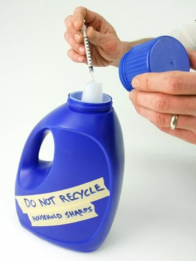 Image of sharps disposal container