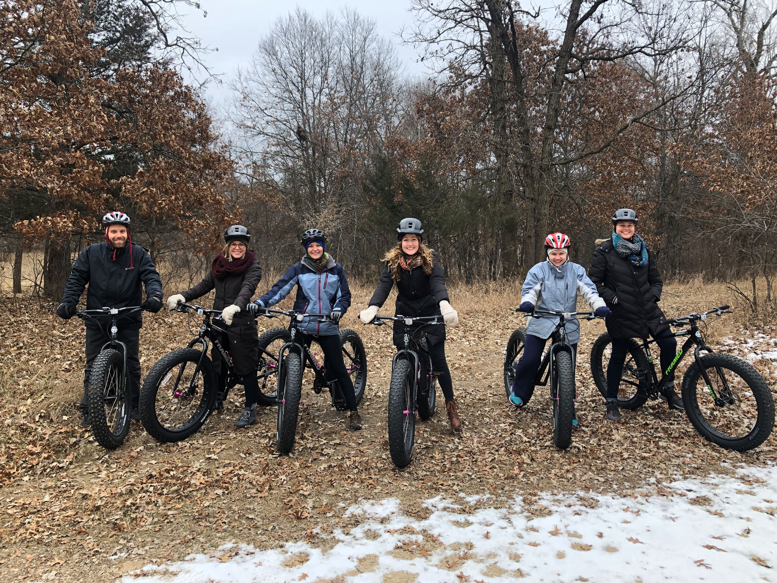 Image of Statewide Health Improvement Partnership Staff riding fat tire bikes