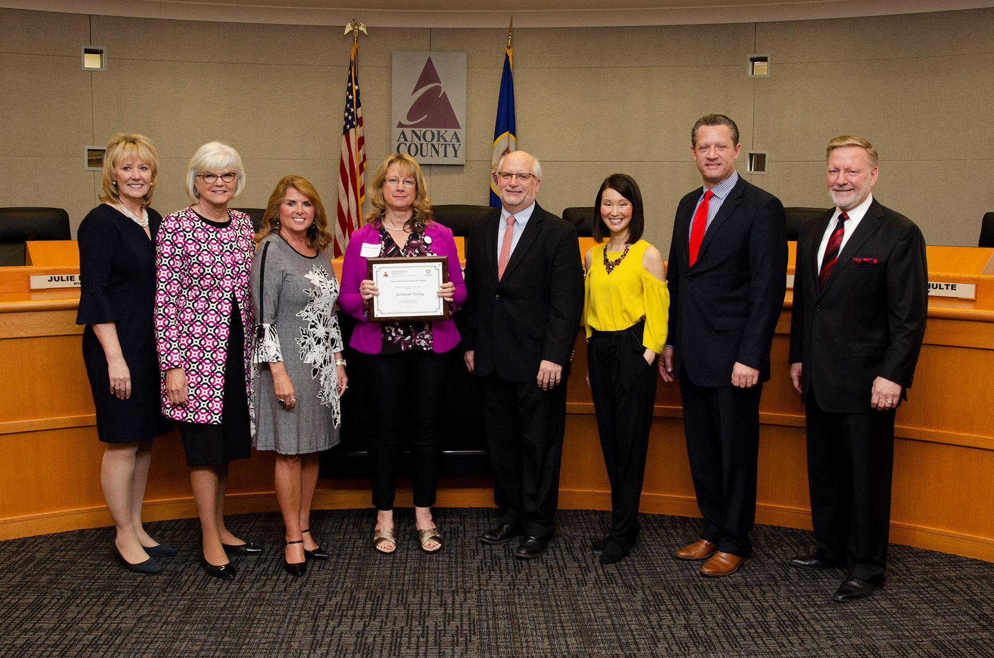 Jeanie Freytag with commissioners receiving award