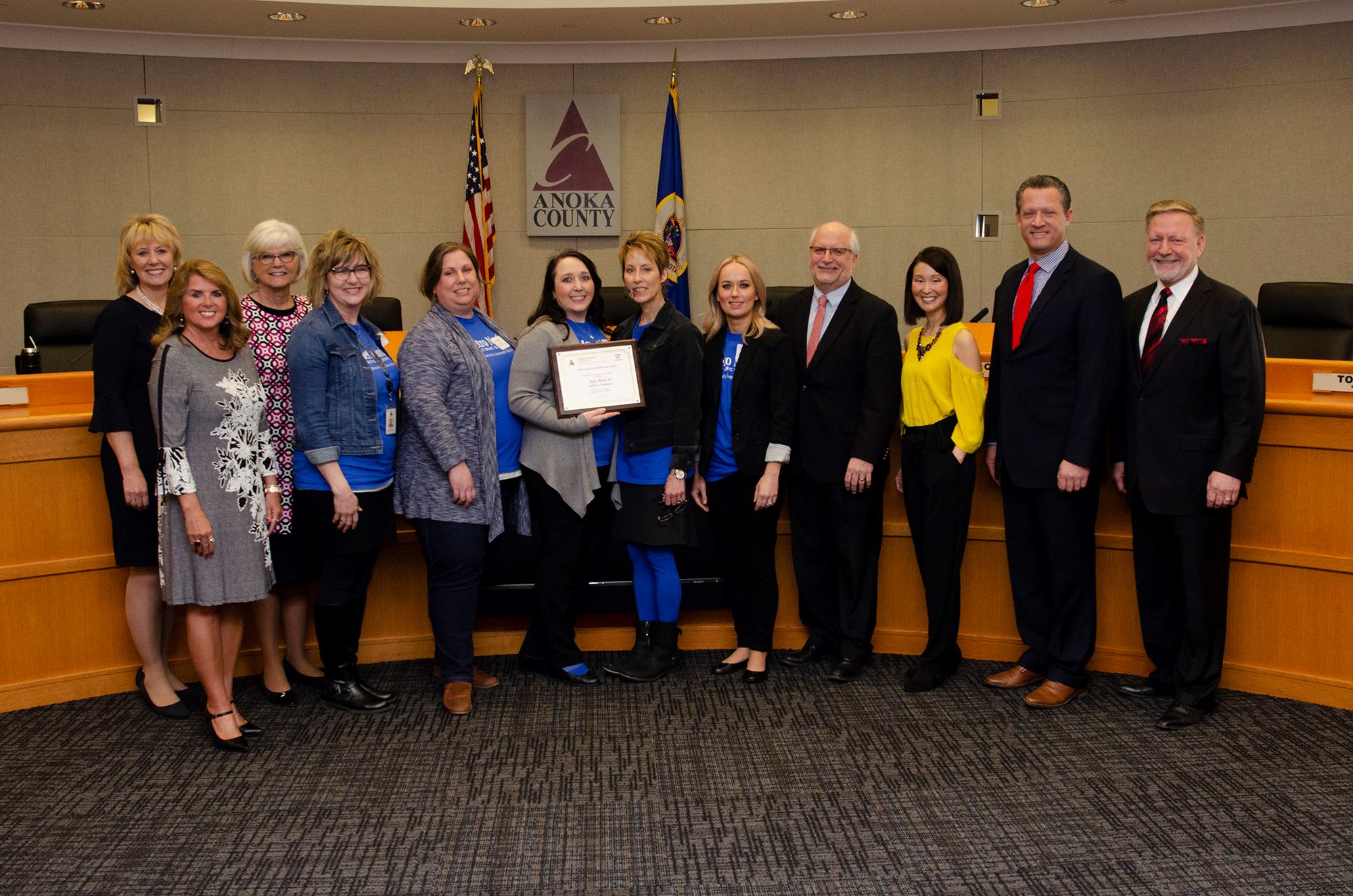 Just Move It Wellness Committee with commissioners receiving award